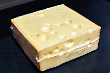 Piece of cheese in vacuum plastic