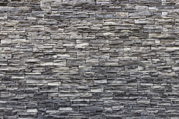 Texture of artificial gray stone wall