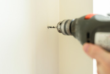 Drilling hole in wall with electric drill
