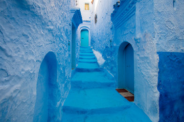 Narrow street and blue houses in Chefchaouen, Morocco