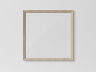 Wooden squared frame hanging on a white wall mockup 3D rendering