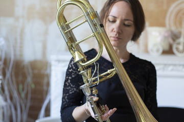 Portrait of a young woman trombonist