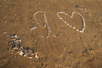 Image drawing in the sand.
