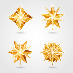 Set of four Christmas realistic metallic golden stars of different shapes