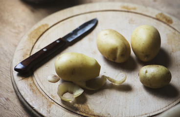 Potatoes peeled on a cutting board