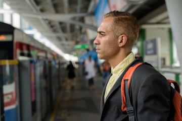 Handsome Persian businessman exploring the city of Bangkok, Thai