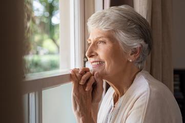 Happy senior woman looking away