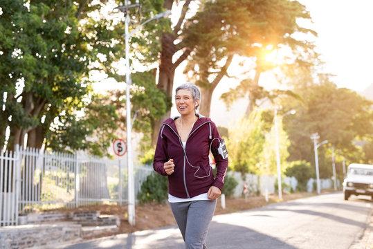 Active senior woman jogging