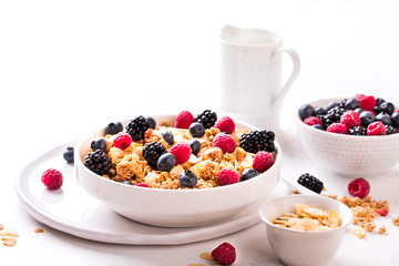 Granola Cereal bar with Strawberries blueberries and Milk on light Background . Muesli Breakfast. Healthy Food sweet dessert snack. Diet Nutrition Concept. Vegetarian food. Copy space for Text.