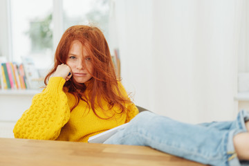 Disgruntled or confused young redhead woman