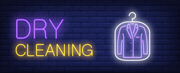 Dry cleaning neon sign. Jacket in plastic bag. Night bright advertisement. Vector illustration in neon style for service, business, fashion