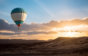 Hot Air Balloon travel over desert