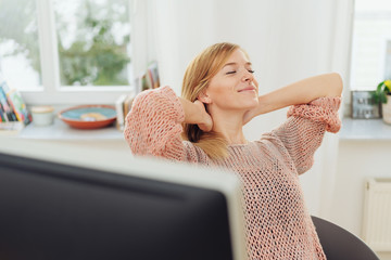 Young businesswoman stretching and relaxing