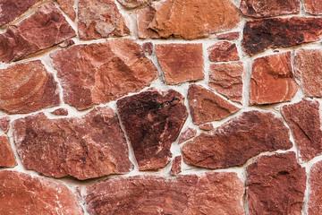 Red encaustic sandstone wall texture