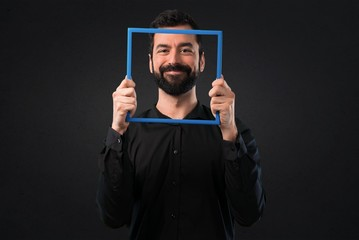 Handsome man with beard with framework on black background