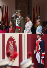 Spain's King Felipe, Queen Letizia and their daughters Princesses Sofia and Leonor  attend a parade as part of celebrations to mark Spain's National Day in Madrid