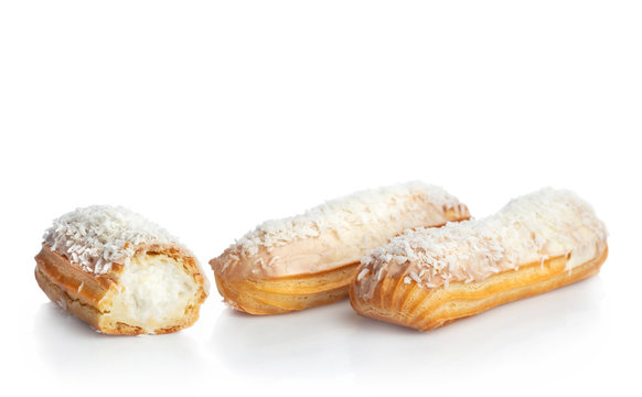 Coconut eclairs isolated on white