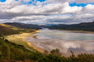 Mawddach river estuary at low tide with views to Snowdonia at low tide, near Barmouth, Wales