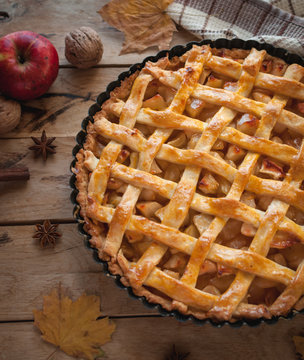 Homemade apple pie on wooden background, top view