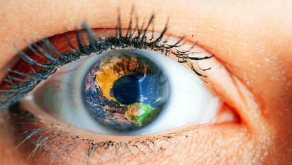 Close up image of human eye with earth in it. Macro Eye w/ Earth as Iris Composite