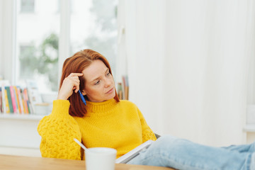 Tired woman relaxing at home with coffee