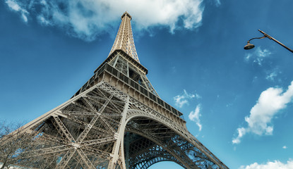 Wall Mural - Upward view of Eiffel Tower on a beautiful sunny winter day - Paris - France