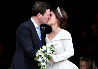 Princess Eugenie and Jack Brooksbank kiss after their wedding at St George's Chapel in Windsor Castle, Windsor