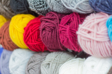 skeins of multi-colored yarn for knitting in the store
