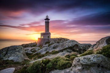 After sunset of The lighthouse of Punta Nariga Malpica in Galicia Spain Wall mural
