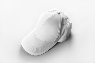 Blank baseball cap on paper background. Responsive design mockup.