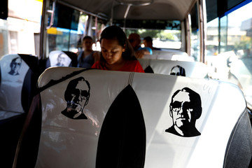 The seats of a public transportation bus are seen decorated with the face of late Archbishop of San Salvador, Mons. Oscar Arnulfo Romero in San Salvador