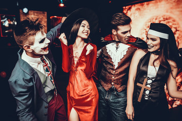 Wall Mural - Group of Friends in Halloween Costumes Dancing