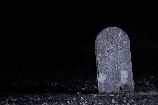 Graveyard Tombstone in Darkness