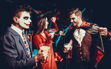 Wall Mural - Young People Drinking Cocktails at Halloween Party