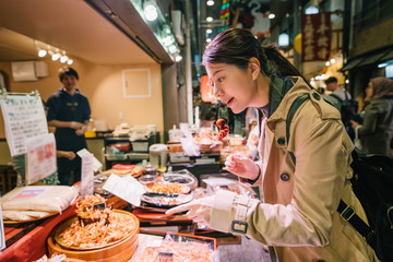tourist pointing to the Japanese street food