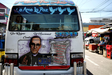 A public transportation bus is seen decorated with a graffiti depicting the late Archbishop of San Salvador, Mons. Oscar Arnulfo Romero in San Salvador