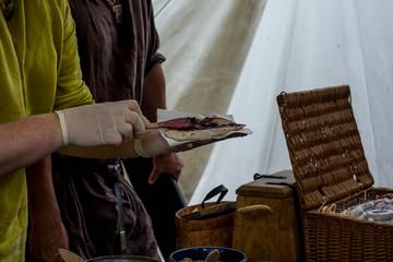 Handing over flatbread with jam