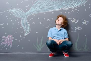 Happy boy under the sea