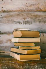 time to read books. books on the table. wooden background. vintage