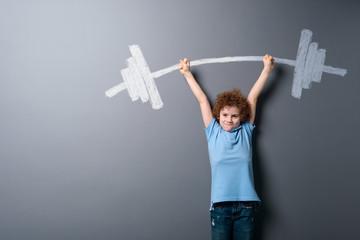 Child raising a barbell