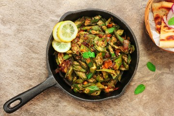 Homemade Bhindi Masala / Okra fry served with Roti, overhead view