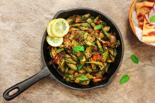 Homemade Bhindi Masala / Okra fry served with Roti, overhead view