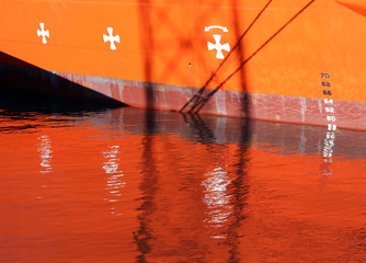 ship bow red reflection in water, St. John's Harbor, Newfoundland, Canada