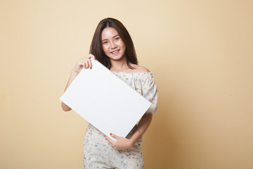 Young Asian woman with white blank sign.