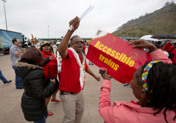 Members of the South African Democratic Teachers Union protest the fuel price increase by blocking the N3 freeway in Marianhill