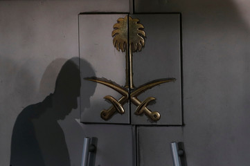 A member of security staff casts shadows at the entrance of Saudi Arabia's consulate in Istanbul