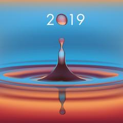 Carte de voeux avec une goutte d'eau en suspension, symbole de pureté, qui forme le zéro de l'année 2019