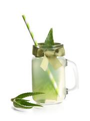 Mason jar with fresh aloe vera juice on white background