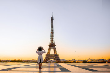 Famous square with great view on the Eiffel tower and woman standing back enjoying the view in Paris