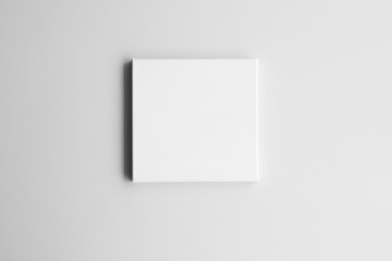 White square canvas on gray wall. Mock-up poster frame in interior.